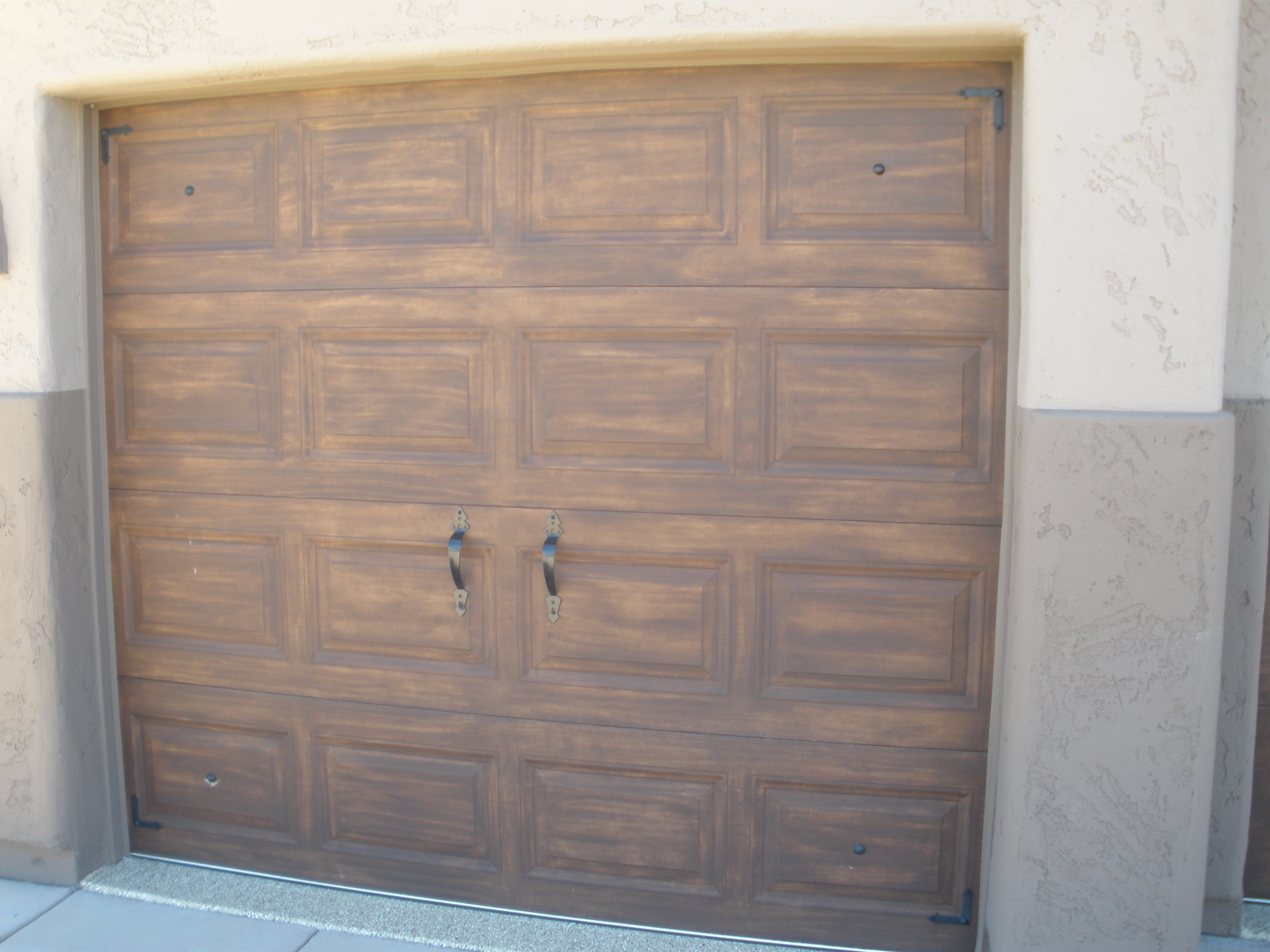 Painted garage doors faux wood to match the door for Faux painted garage doors