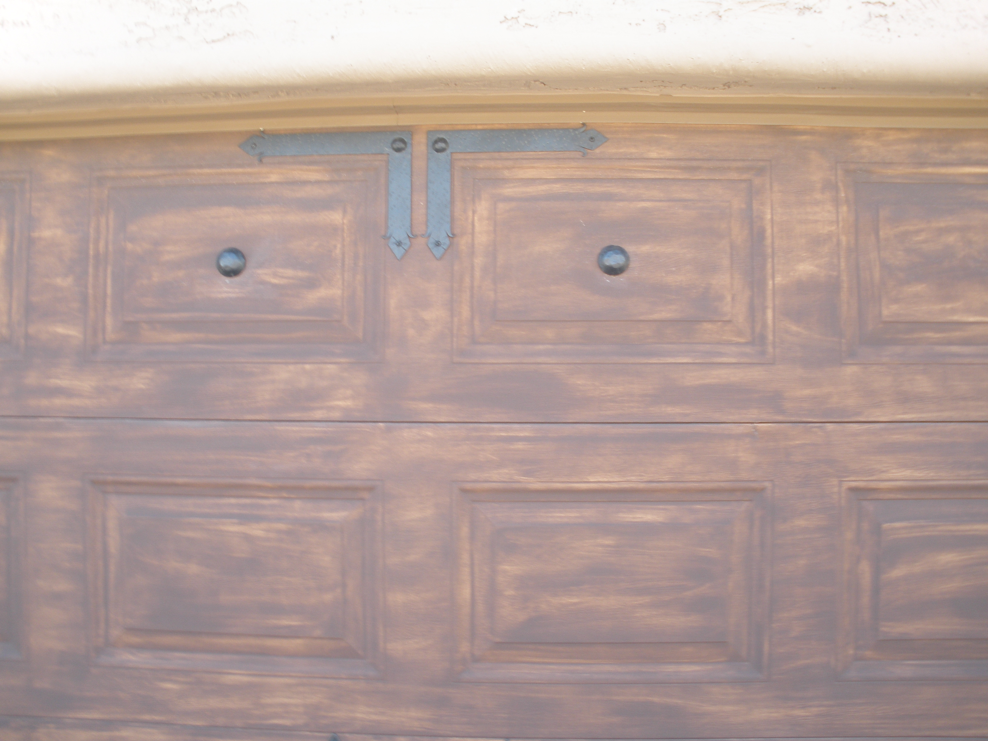 Painted garage doors faux wood to match the door close up Faux wood garage door paint